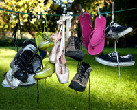 Sport shoes on clothes line7756